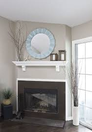 white shelf light blue mirror dark wood candle bo branches corner fireplacesfireplace