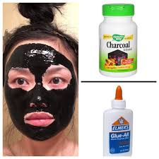 diy charcoal mask open capsules and use a brush to mix spoonful of glue