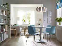 ikea white living room furniture. A Dining Room With Round White Table Combined Light Blue Chairs Stainless Ikea Living Furniture