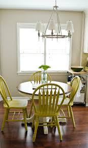 use diy chalk paint to refinish an old oak table and chairs best part is there is no sanding and if you the color you and just paint over the entire