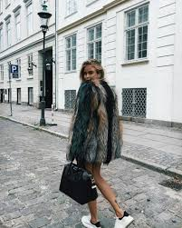 i remember those times when faux fur clothes considered to be something and weird as everyone dreamed of a real fur coat