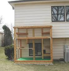 contemporary outdoor cat enclosure diy christensen pet connected to house kit attached plan uk canada for window
