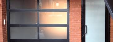 aluminum glass garage doors are a modern trend for homes commercial businesses