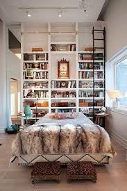 view in gallery incredible bookshelf that reaches all the way up to the high ceilings