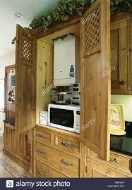 Open Kitchen Cupboard Doors Open To Kitchen Cupboard With Central Heating Boiler Above