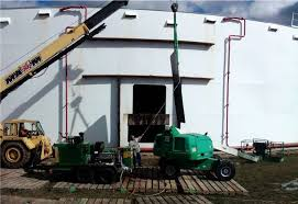 petroleum ast tank cleaning crew making entry way oil tank cleaning equipment