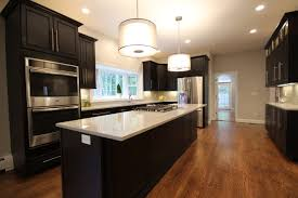 kitchens with dark cabinets and light countertops. Kitchen With Wood Floor, Dark Cabinets, Light Countertops And Pendant Lighting Kitchens Cabinets