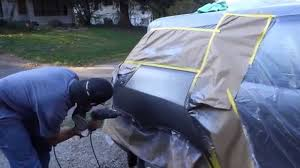 mobile auto work paint job fixing a dent with a uni spotter you