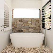 small bathroom wall tile. Half Wall In Natural Stone And Pebbles On The Floor Turn Small Bathroom Into Tile