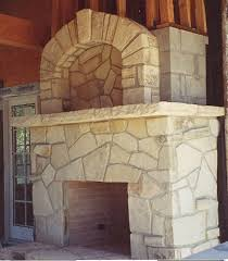 carmel stone fireplace face a massive country fireplace with raised hearth and surround has a mantelshelf topped with an immense over mantel with