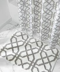 love this white stone trellis bath rug