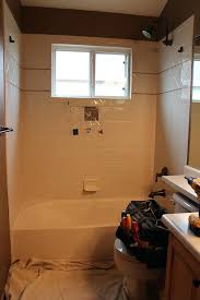 replacing shower tiles on walls removing