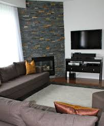 Decorations:Interesting Long Stacked Stone Corner Fireplace With Grey  Fabric Sofa Also Modern Tv Wall