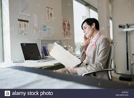 Doctor Reading Chart Doctor Reading Chart Stock Photos Doctor Reading Chart