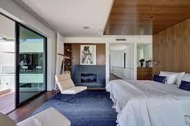 navy blue rugs with modern bedroom and window treatments wood flooring navy blue rug dark floor black and white art
