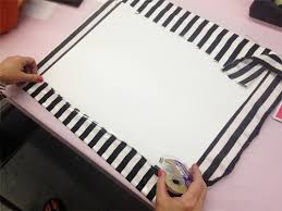 1 remove the insert from your frame and tack out the paper cardboard sheet cut a piece of fabric larger than the sheet and wrap it around  on poster board wall art with ilovetocreate blog make polka dot framed pumpkin wall art