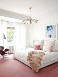 blush pink bedroom with poster accessories on we wear