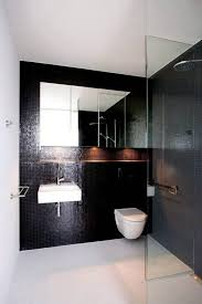 black modern bathroom toilet. modern bathroom with black tiles and wall mounted toilet also sink b