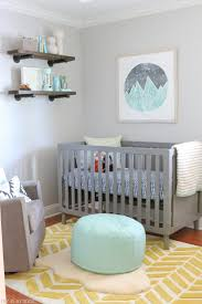 Gender Neutral Nursery Reveal - DIY Playbook Loving this gender neutral  nursery! That gray crib with the wood accents and pop of color is perfect  for any ...