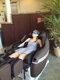 massage chair. photo of girl in a massage chair