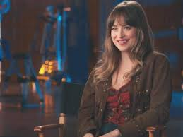 Dakota Johnson at war with neighbours | English Movie News - Times of India