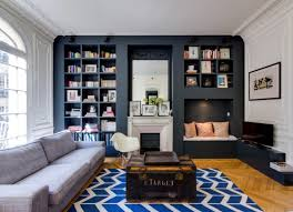 a parisian family room that s perfectly polished with plenty of space for family members of all ages children love to sit in the built in daybed by the