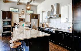 kitchen with african rainbow granite with dark cabinets
