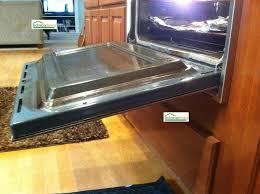 kitchenaid oven door falls open
