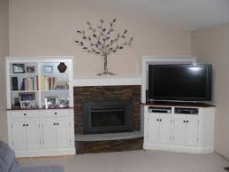 Floating Shelves Around Tv White Wooden Shelves With Doors Connected By Brown Stone Fireplace