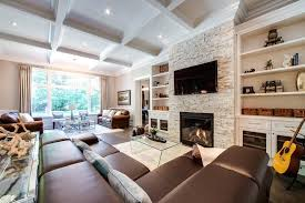 white stacked stone fireplace distressed leather sectional family room traditional with bar stools and counter veneer