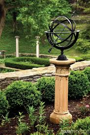 armillary sphere contrasts with the nearby plants