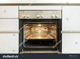 open oven in kitchen. modern kitchen, inside of the oven, open oven in kitchen d