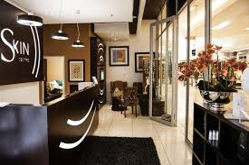 beauty salon lighting. The Solid Black Reception Counter, With Its Custom CNC Cut-out Branded Lighting Display, Serves As Both Focal Point For Salon Design And Beauty R