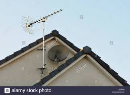 tv aerial. stock photo - tv aerial and satellite dish on gable wall of modern house tv
