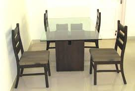 dining table with 4 chairs by designer glass top wood