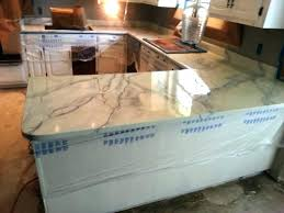 carrera marble countertop 4 beautiful white kitchens throughout plans carrara countertops cost per square foot