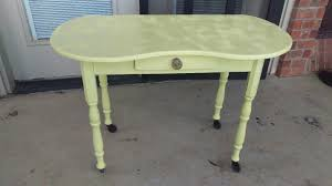 spray painting furniture yellow table finished