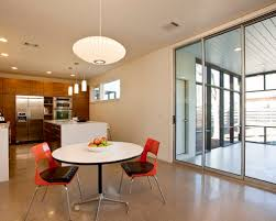 midcentury lighting. midsized contemporary concrete floor great room idea in austin with white walls midcentury lighting o