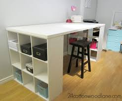 Easy DIY craft room desk made from an old door and 9 cube shelving unit.