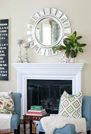 simple living room. make your fireplace\u0027s mantel pop by using a few bright pieces, like this room\u0027s mirror and silver candlestick holders. simple living room