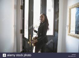 walking through front door. Businesswoman Walking Through Her Front Door I