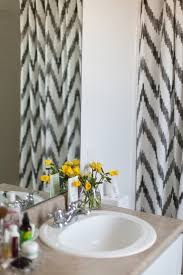 stunning bathroom with drop in tub and west elm chevron shower curtain grey and scout