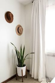 High Quality The Corner Of A Room With White Walls. Two Hats Are Hung On The Wall