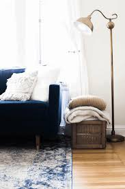 navy couch decorating ideas black stained malsjo glass door cabinet white textured area rugs blue glass end table twin soft modern pouffe metal lounge chair