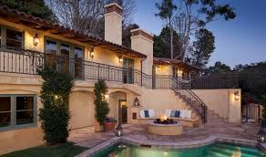 mediterranean outdoor lighting. Mediterranean-exterior-design-with-brick-chimney-and-iron- Mediterranean Outdoor Lighting [
