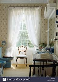 Patterned Curtains Living Room Patterned Curtains With Voile Drapes In A Red Economy Style