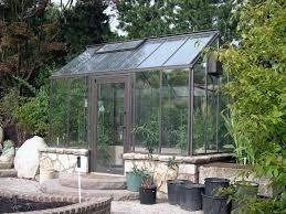 image of modern glass greenhouse kits