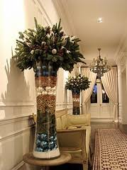 Great idea for a very tall glass vase...use generic greens and seasonal  fillers | Holiday Crafts | Pinterest | Glass, Holidays and Xmas