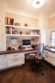 built in shelves over the desk for easy storage and access