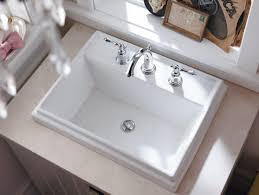 rectangle kohler archer sink with double handle stainless steel faucet also wood vanity for bathroom design